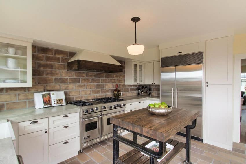 Rustic kitchen with large brick wall
