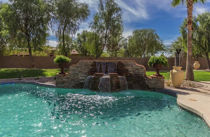 Stacked stone waterfall in swimming pool