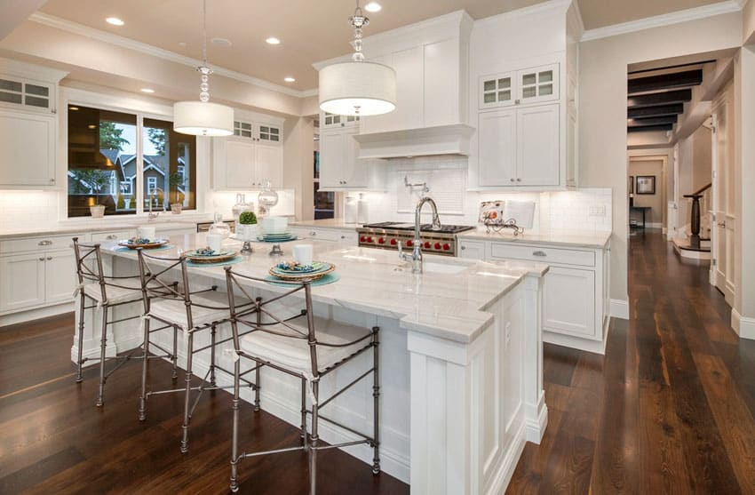 Traditional white kitchen with breakfast bar island and farmhouse sink