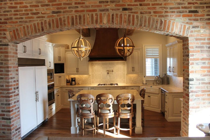 Traditional kitchen with brick archway entry