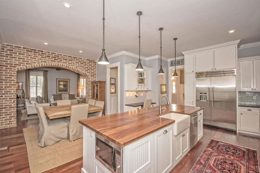 Traditional white cabinet kitchen with brick archway
