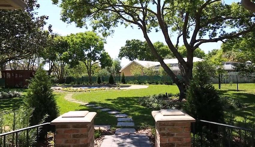 Backyard stepping stone path to swimming pool