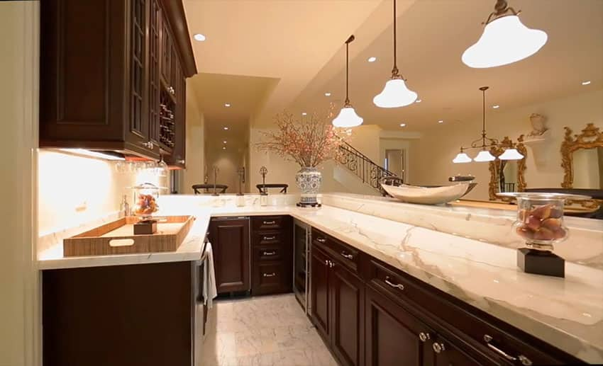 Basement kitchen with dark cabinetry