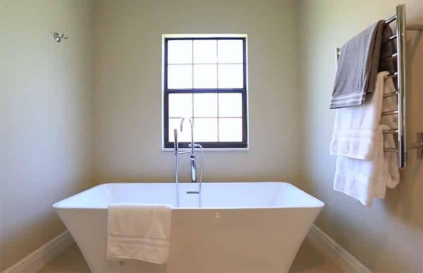Bathroom with contemporary bathtub and window
