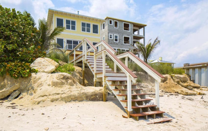 Beach home design with stairs to ocean