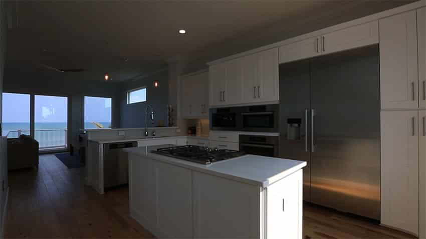 Beach house kitchen with ocean view at night