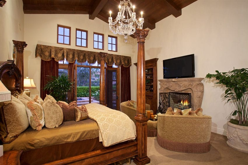 Beautiful luxury master bedroom with fireplace and window views
