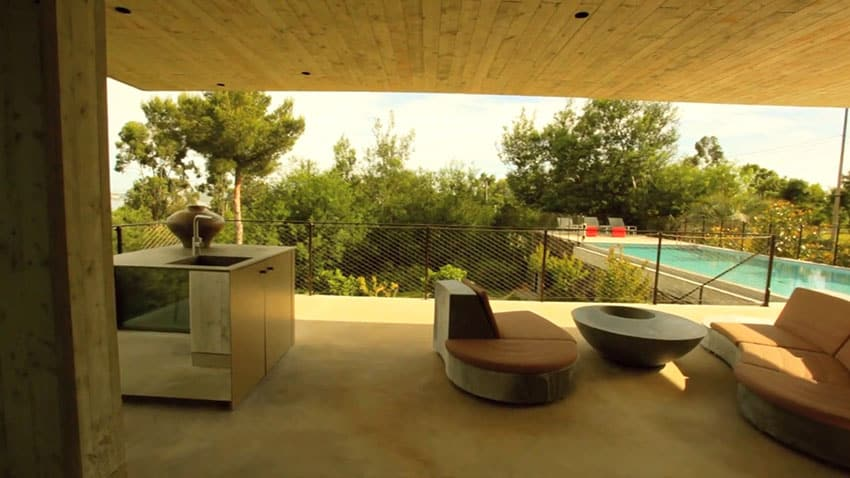 Concrete pool patio at modern house
