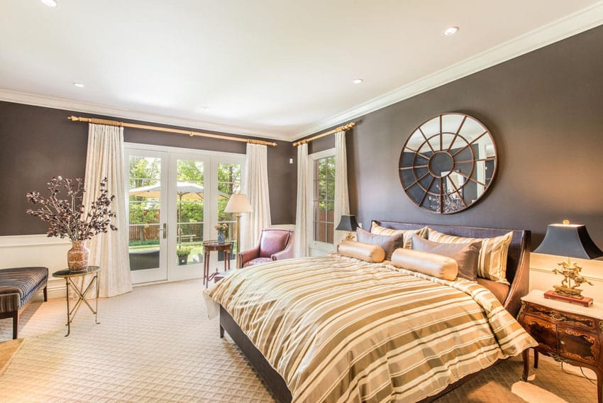 Contemporary bedroom with french doors to patio