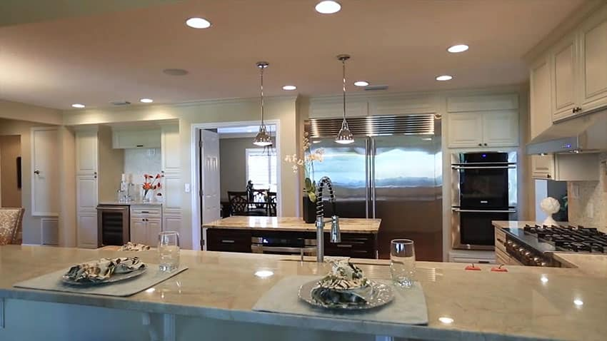 Contemporary kitchen with quartz counters and dining peninsula