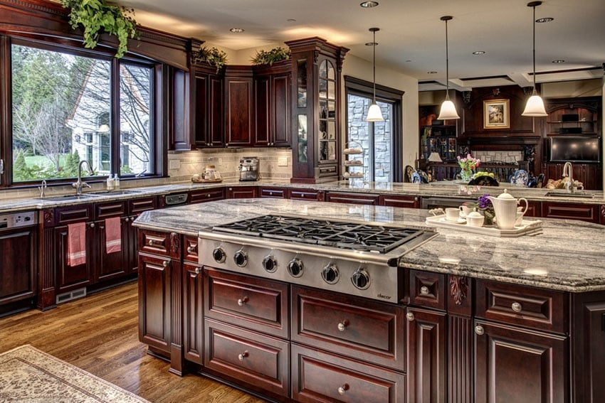 Craftsman kitchen with dark raised panel wood cabinets