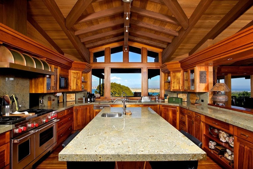 Custom wood kitchen with water views and gray quartz counters