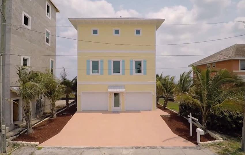 Cute beach house in yellow