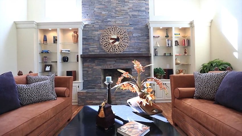 Formal living room with contemporary furniture and stacked stone fireplace