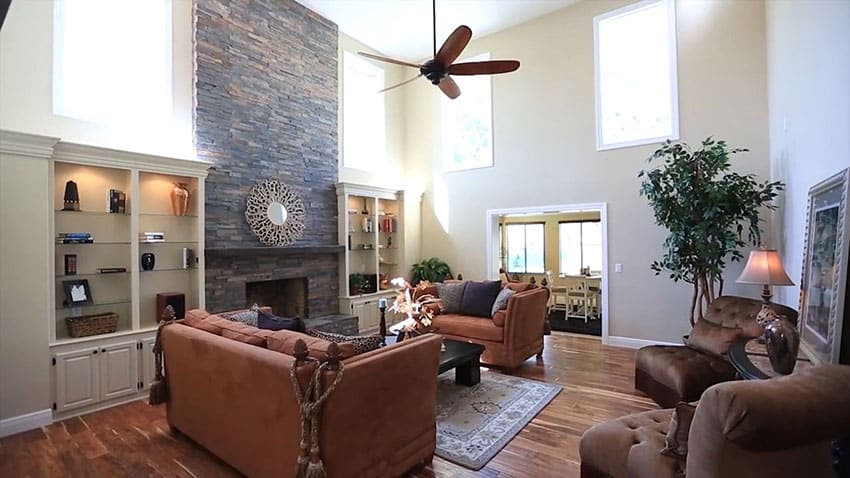 Furnished contemporary living room with fireplace and high ceilings
