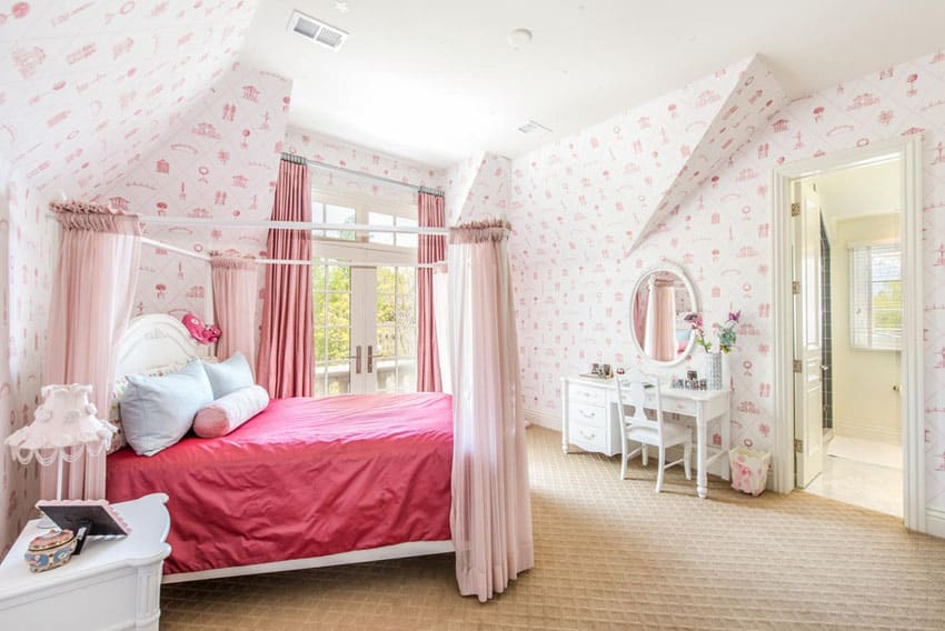 Girls bedroom with princess bed pink wallpaper