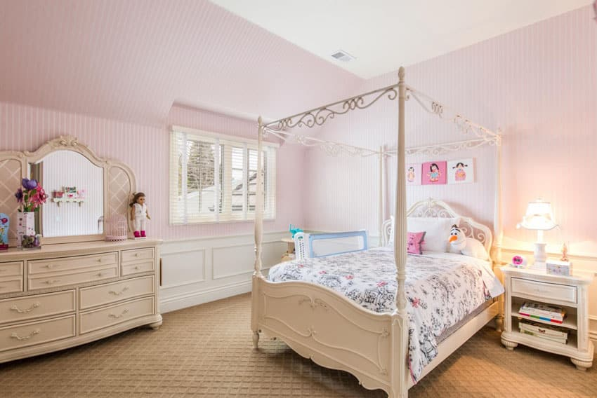 Girls pink bedroom with four post bed