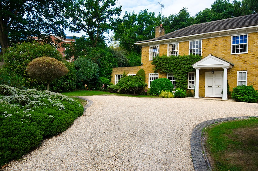 Gravel driveway at English countryside house