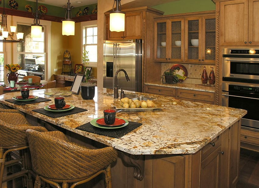 Kitchen with custom wood cabinetry and beige granite counters