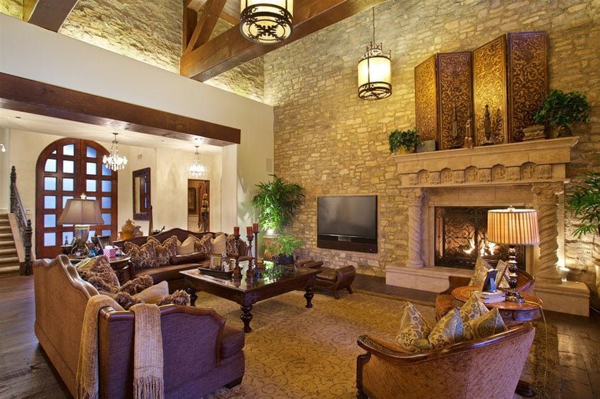 Living room with decorative fireplace and high ceiling