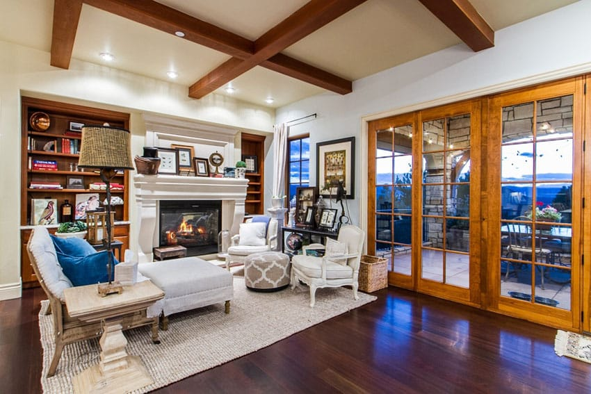 Living room with exposed beam ceiling and African mahogany hardwood flooring