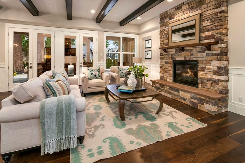 Living room with exposed beam ceiling and walnut hardwood floors