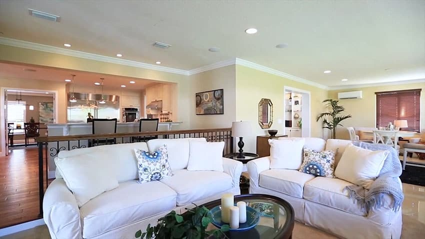 Living room with white couches dark coffee table