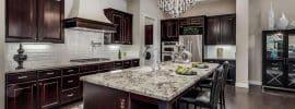 luxury-dark-cabinet-kitchen-with-custom-range-hood