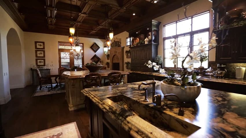 Luxury Tuscan style kitchen with rustic tile islands