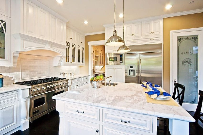 Luxury white cabinet kitchen with marble countertops