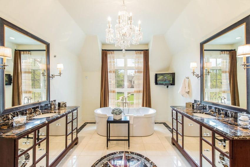 Master bathroom at French provincial house with chandelier