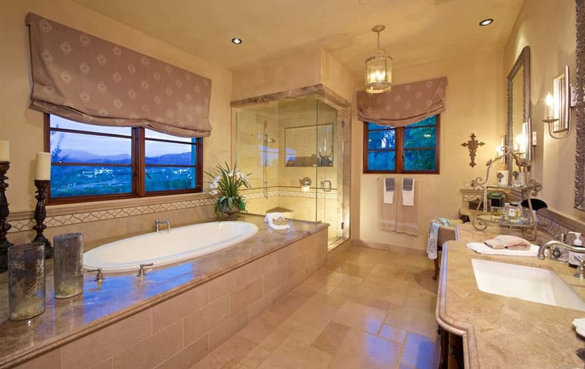 Master bathroom with enclosed tub and glass shower