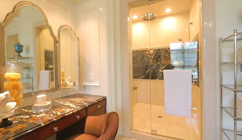 Master bathroom with shower and makeup counter