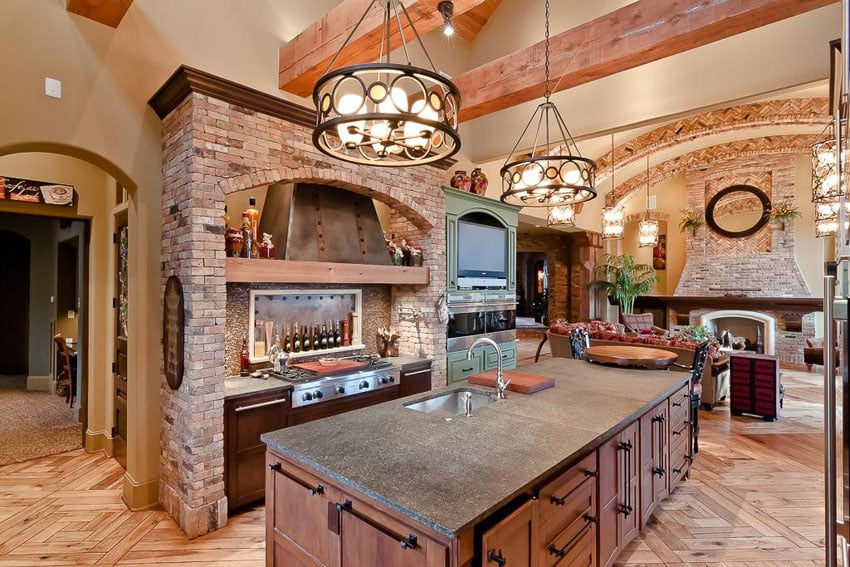 Mediterranean kitchen with exposed wood beams and large island