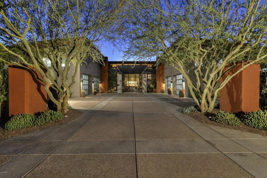 Modern concrete and aggregate driveway at luxury home