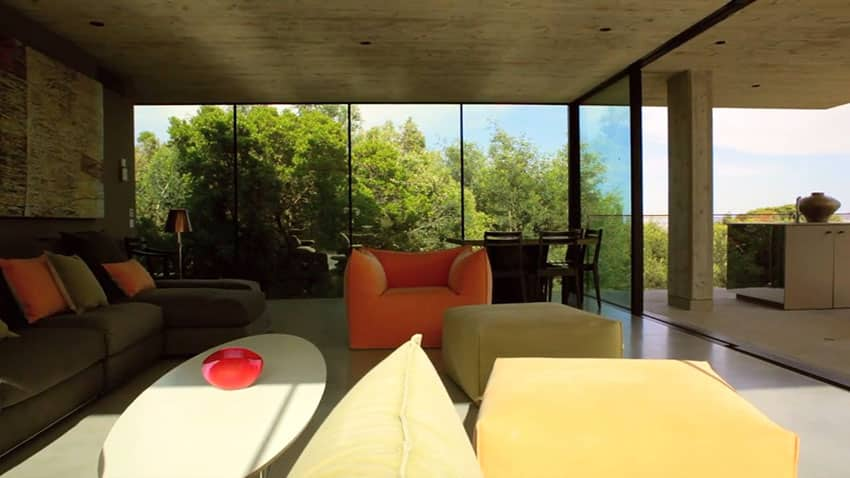 Modern living room with concrete walls and amazing view