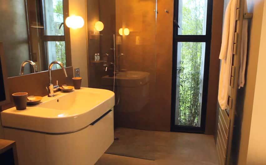 Modern shower with window view of garden