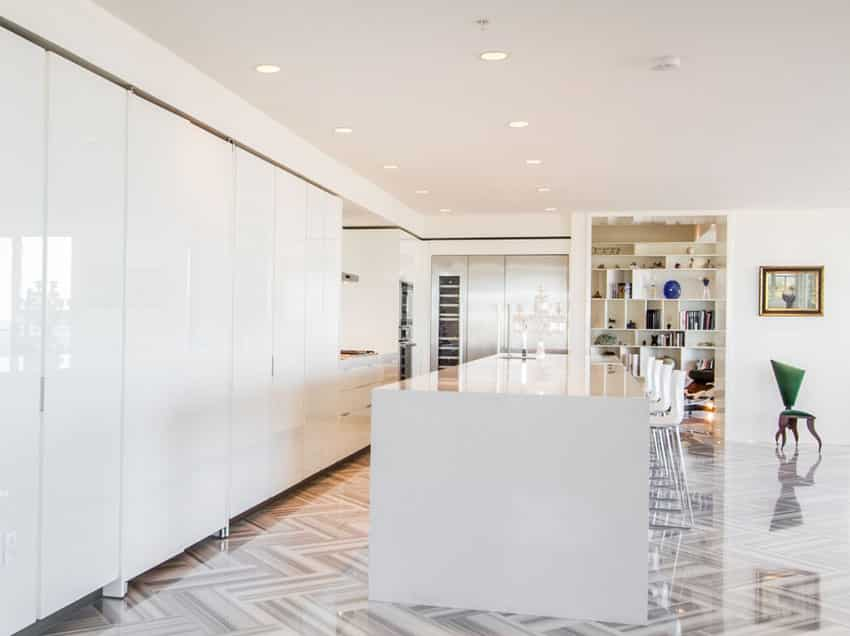 Modern white cabinet kitchen with quartz countertop and porcelain tile floors