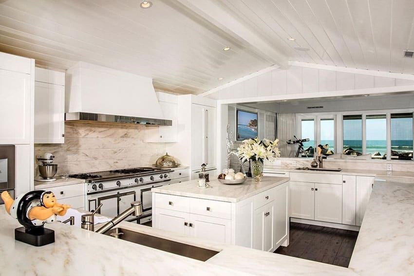 Oceanview kitchen with white cabinets and calacatta splendor marble counters