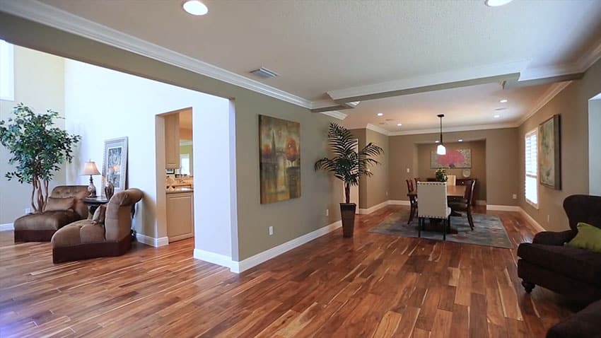 Open concept dining room with acacia wood flooring