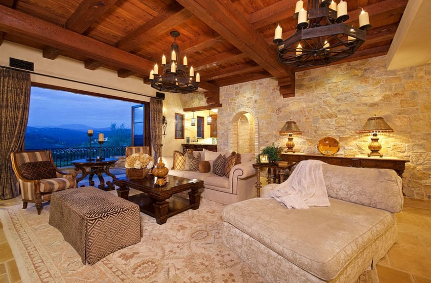 Rustic living room with stone wall and luxury furnishings