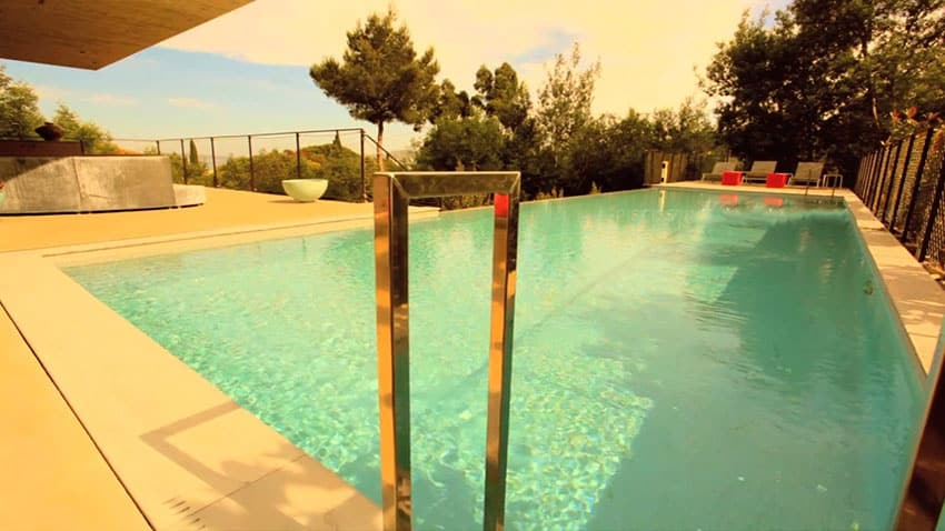 Swimming pool view at modern concrete and glass home