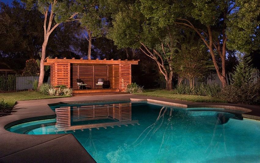 Swimming pool with sitting area pergola