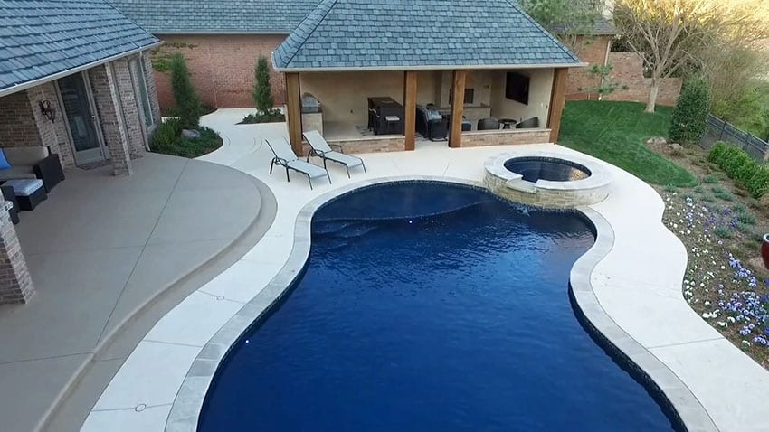 Swimming pool with travertine coping and luxury cabana