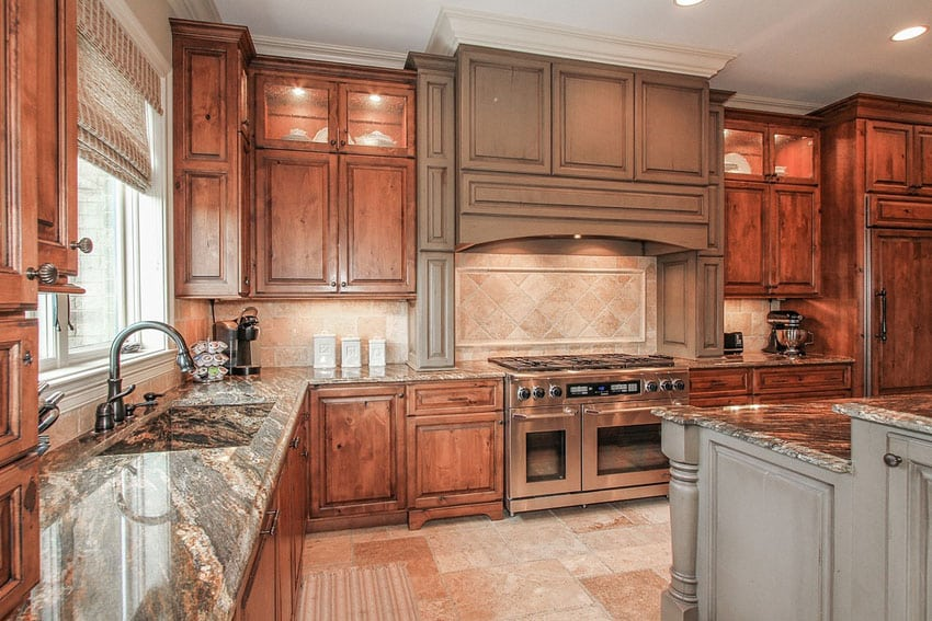 Traditional kitchen with complex granite counters and rustic wood cabinetry
