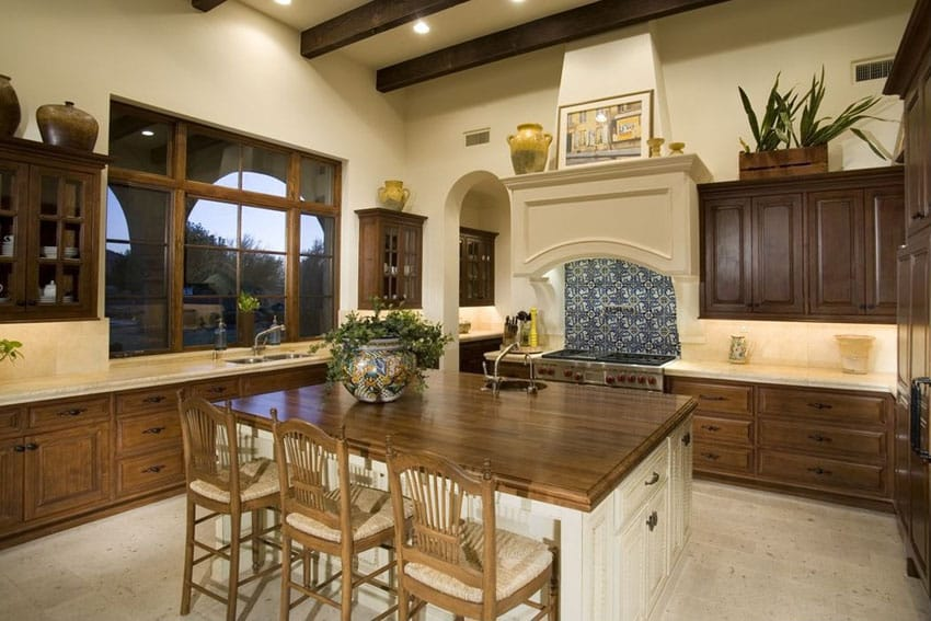 Traditional kitchen with raised cabinetry and butcher block dining island