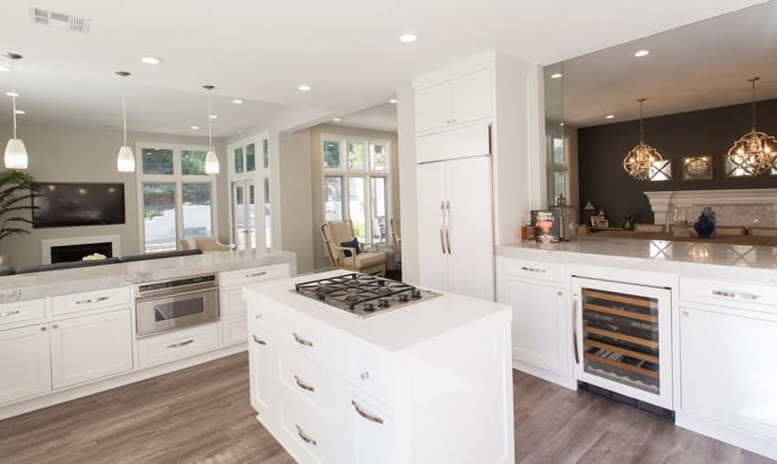 Transitional kitchen with white cabinets small island with stovetop wine fridge