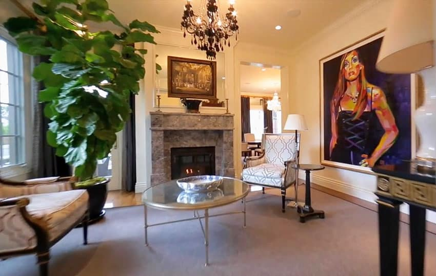 Upscale living room space with fireplace and art