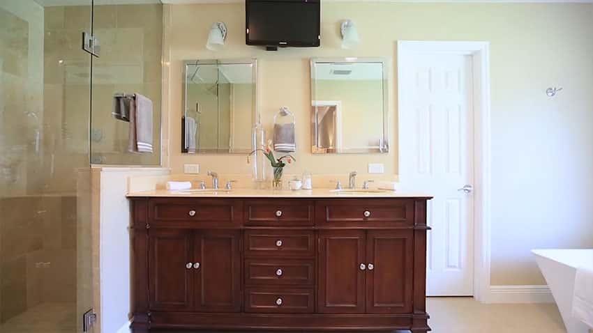 View of dual sink vanity shower and bathtub