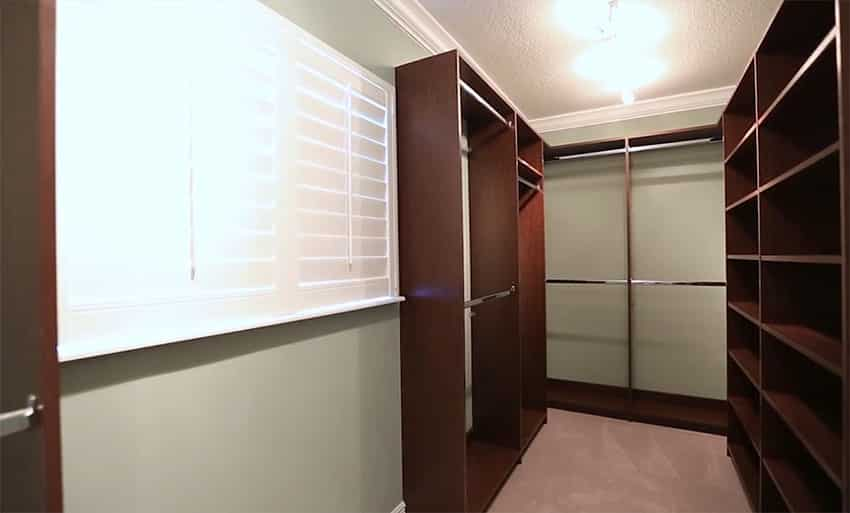 Walk in closet with plantation shutters